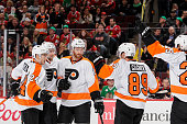 Andrew MacDonald of the Philadelphia Flyers celebrates with teammates including Matt Read and Sean Couturier after scoring in the first period of the...