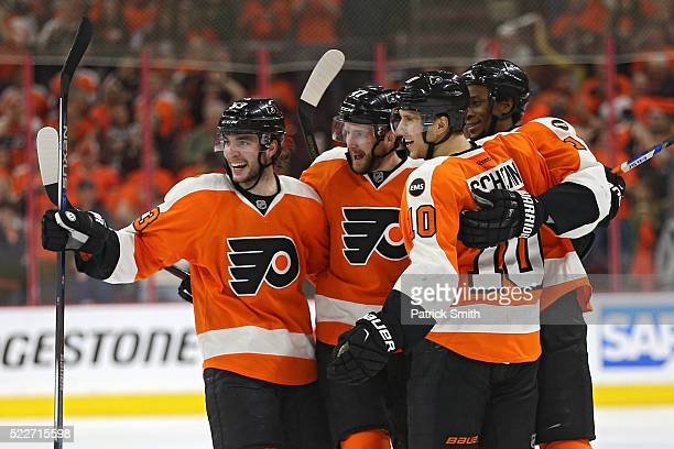 Andrew MacDonald of the Philadelphia Flyers celebrates with teammates after scoring against the Washington Capitals during the second period in Game...