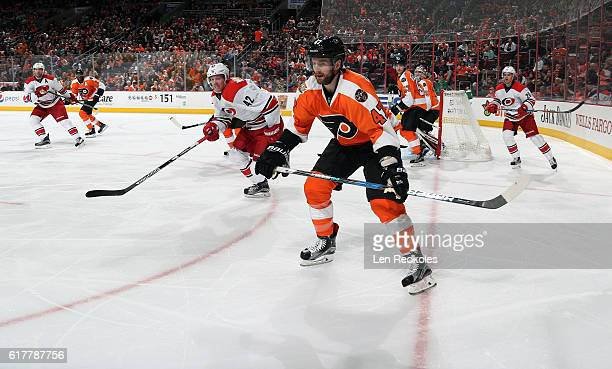 Andrew MacDonald of the Philadelphia Flyers in action against Joakim Nordstrom of the Carolina Hurricanes on October 22 2016 at the Wells Fargo...