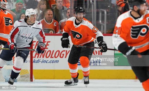 Andrew MacDonald of the Philadelphia Flyers in action against TJ Oshie of the Washington Capitals on October 14 2017 at the Wells Fargo Center in...