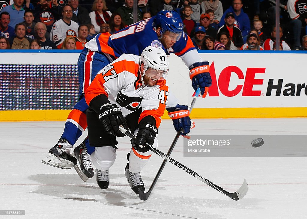 Andrew MacDonald of the Philadelphia Flyers is pursued Kyle Okposo of the New York Islanders at Nassau Veterans Memorial Coliseum on January 19 2015...