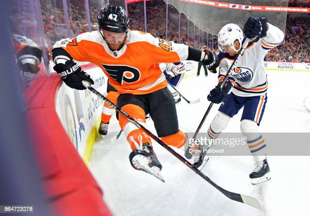 Andrew MacDonald of the Philadelphia Flyers scrums in the corner with Ryan Strome of the Edmonton Oilers at the Wells Fargo Center on October 21 2017...