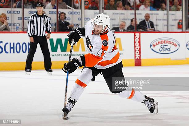 Andrew MacDonald of the Philadelphia Flyers shoots the puck against Arizona Coyotes during the NHL game at Gila River Arena on October 15 2016 in...