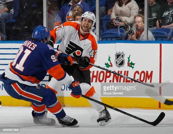 Andrew MacDonald of the Philadelphia Flyers skates against the New York Islanders at the Nassau Veterans Memorial Coliseum on November 24 2014 in...