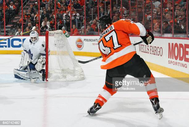 Andrew MacDonald of the Philadelphia Flyers takes a shot on goal against Curtis McElhinney of the Toronto Maple Leafs on January 26 2017 at the Wells...