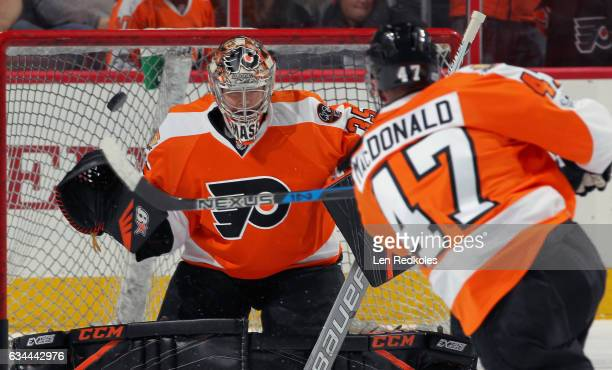 Andrew MacDonald of the Philadelphia Flyers takes a shot on goaltender Steve Mason during warmups prior to their game against the New York Islanders...