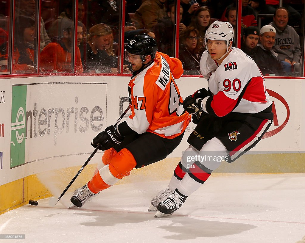 Andrew MacDonald #47 of the Philadelphia Flyers takes the puck as Alex Chiasson #90 of the Ottawa Senators defends on January 6, 2015 at the Wells Fargo Center in Philadelphia, Pennsylvania.