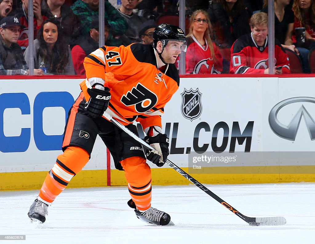 Andrew MacDonald #47 of the Philadelphia Flyers takes the puck in the first period against the New Jersey Devils on March 8, 2015 at the Prudential Center in Newark, New Jersey.