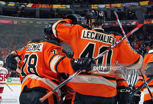 Andrew MacDonald PierreEdouard Bellemare Vincent Lecavalier and Nicklas Grossmann of the Philadelphia Flyers celebrate a third period goal against...