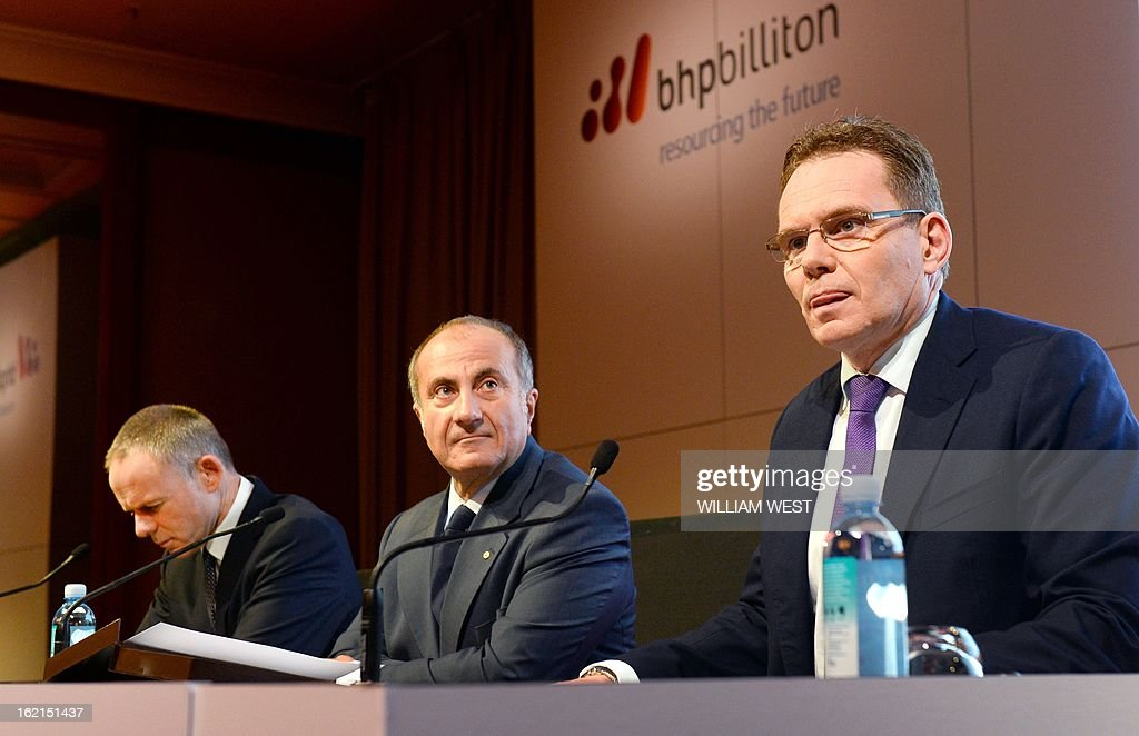 Andrew Mackenzie (R) attends a press conference where it was announced he would replace BHP Billiton CEO Marius Kloppers (L) on May 10 as company chairman Jac Nasser (C) looks on, in Sydney on February 20, 2013. The 56-year-old Mackenzie, currently chief executive non-ferrous, has over 30 years experience in oil and gas, petrochemicals and minerals and joined BHP Billiton in November 2008. South African Kloppers has been running the world's largest miner since October 2007, steering it through the global financial crisis. AFP PHOTO/William WEST
