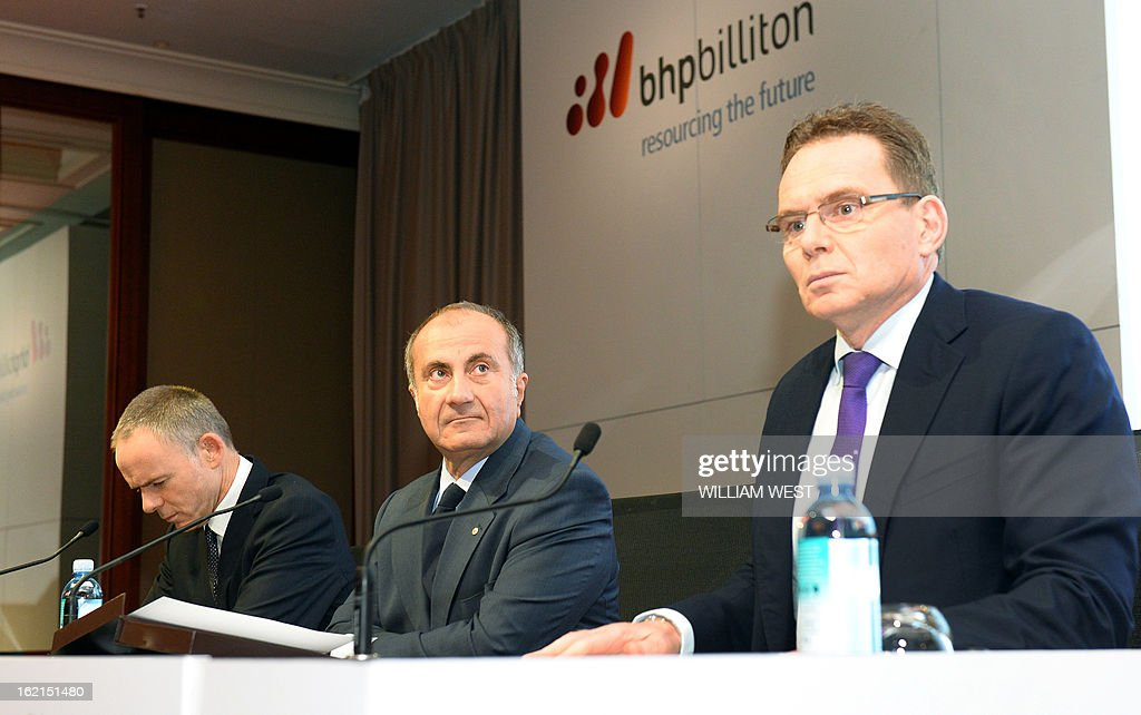 Andrew Mackenzie (R) attens a press conference where it was announced he would replace BHP Billiton CEO Marius Kloppers (L) on May 10 as company chairman Jac Nasser (C) looks on, in Sydney on February 20, 2013. The 56-year-old Mackenzie, currently chief executive non-ferrous, has over 30 years experience in oil and gas, petrochemicals and minerals and joined BHP Billiton in November 2008. South African Kloppers has been running the world's largest miner since October 2007, steering it through the global financial crisis. AFP PHOTO/William WEST