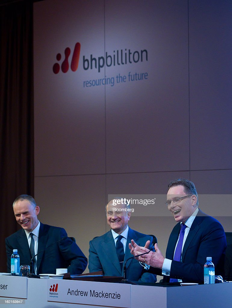 Andrew Mackenzie, chief executive officer for non-ferrous at BHP Billiton Ltd., right, speaks as <a gi-track='captionPersonalityLinkClicked' href=/galleries/search?phrase=Marius+Kloppers&family=editorial&specificpeople=4467222 ng-click='$event.stopPropagation()'>Marius Kloppers</a>, chief executive officer, left, and Jacques 'Jac' Nasser, chairman, smile during a news conference in Sydney, Australia, on Wednesday, Feb. 20, 2013. BHP Billiton, the world's biggest mining company, named its copper unit head Andrew Mackenzie as chief executive officer to succeed <a gi-track='captionPersonalityLinkClicked' href=/galleries/search?phrase=Marius+Kloppers&family=editorial&specificpeople=4467222 ng-click='$event.stopPropagation()'>Marius Kloppers</a> before reporting a 58 percent decline in first-half profit. Photographer: Ian Waldie/Bloomberg via Getty Images