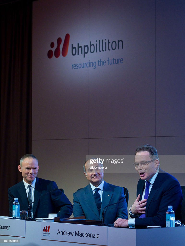 Andrew Mackenzie, chief executive officer for non-ferrous at BHP Billiton Ltd., right, speaks as Marius Kloppers, chief executive officer, left, and Jacques 'Jac' Nasser, chairman, smile during a news conference in Sydney, Australia, on Wednesday, Feb. 20, 2013. BHP Billiton, the world's biggest mining company, named its copper unit head Andrew Mackenzie as chief executive officer to succeed Marius Kloppers before reporting a 58 percent decline in first-half profit. Photographer: Ian Waldie/Bloomberg via Getty Images