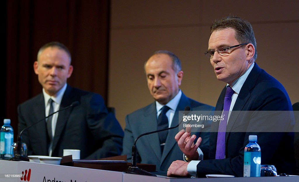 Andrew Mackenzie, chief executive officer for non-ferrous at BHP Billiton Ltd., right, speaks as Marius Kloppers, chief executive officer, left, and Jacques 'Jac' Nasser, chairman, look on during a news conference in Sydney, Australia, on Wednesday, Feb. 20, 2013. BHP Billiton, the world's biggest mining company, named its copper unit head Andrew Mackenzie as chief executive officer to succeed Marius Kloppers before reporting a 58 percent decline in first-half profit. Photographer: Ian Waldie/Bloomberg via Getty Images