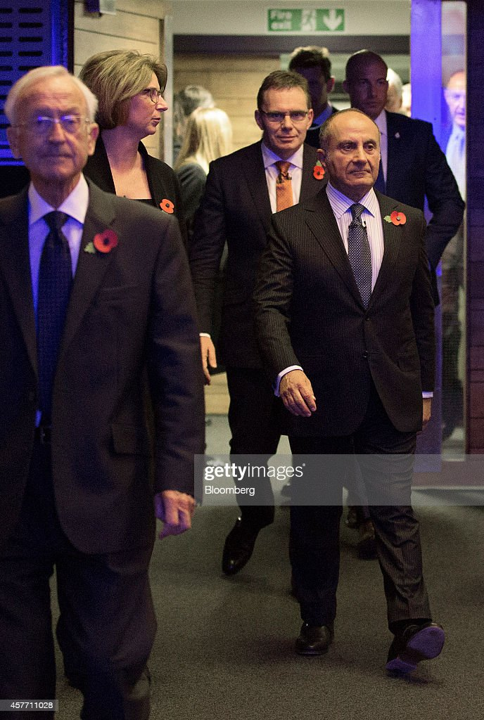 Andrew Mackenzie, chief executive officer of BHP Billiton Ltd., center, and Jacques 'Jac' Nasser, chairman of BHP Billioton Ltd., right, arrive ahead of the company's annual general meeting (AGM) in London, U.K., on Thursday, Oct. 23, 2014. BHP Billiton Ltd., the world's biggest mining company, said first-quarter iron ore output rose 17 percent as it continues to expand production in the face of tumbling prices. Photographer: Simon Dawson/Bloomberg via Getty Images