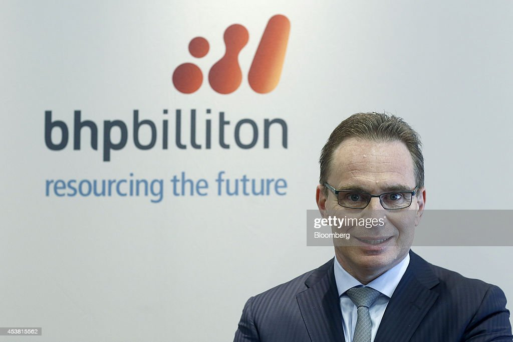 Andrew Mackenzie chief executive officer of BHP Billiton Ltd poses for a photograph ahead of a news conference at the London Stock Exchange in London...