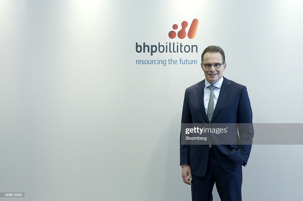 Andrew Mackenzie, chief executive officer of BHP Billiton Ltd., poses for a photograph ahead of a news conference at the London Stock Exchange in London, U.K., on Tuesday, Aug. 19, 2014. BHP Billiton announced what's poised to be the biggest spinoff in the mining industry, separating aluminum, coal and silver assets to create a company valued at about $15 billion after it begins trading next year. Photographer: Simon Dawson/Bloomberg via Getty Images