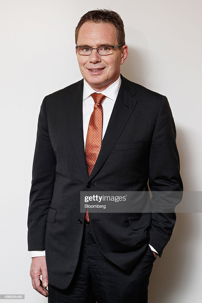 Andrew Mackenzie chief executive officer of BHP Billiton Ltd poses for a photograph following a Bloomberg Television interview in Sydney Australia on...