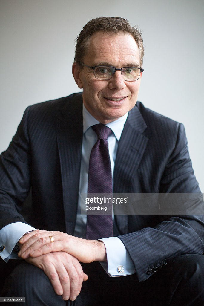 Andrew Mackenzie chief executive officer of BHP Billiton Ltd poses for a photograph after presenting the company's fullresults to the media in London...