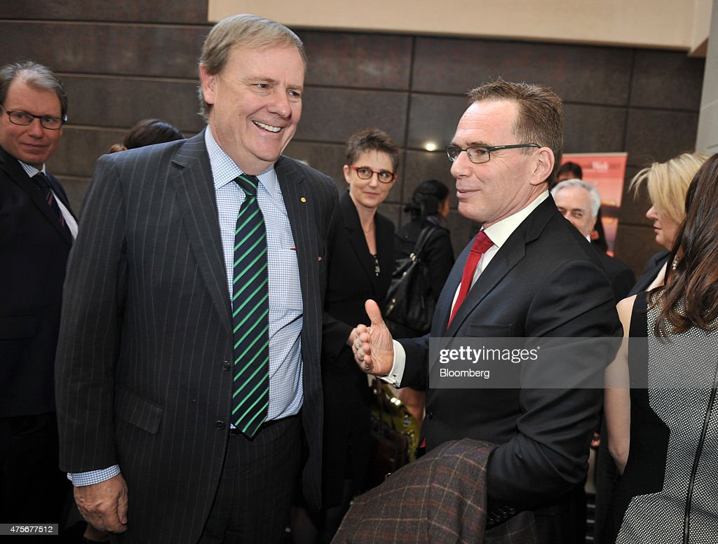 Andrew Mackenzie chief executive officer of BHP Billiton Ltd right speaks with Peter Costello chairman of the Australian Government Future Fund at...