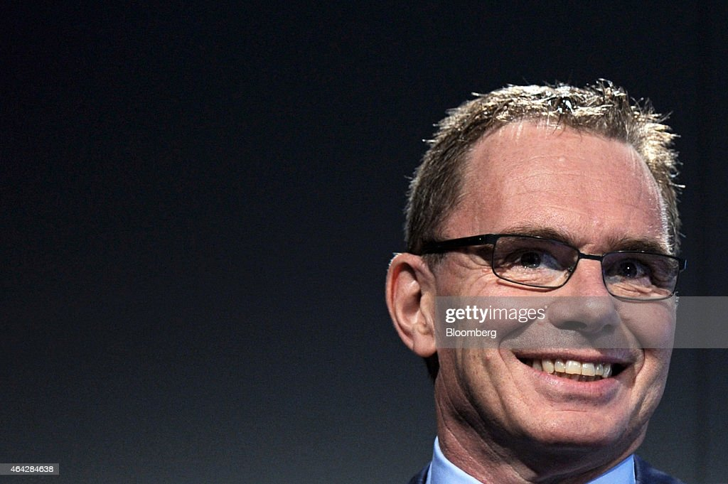 Andrew Mackenzie, chief executive officer of BHP Billiton Ltd., smiles during an investor briefing at the company's headquarters in Melbourne, Australia, on Tuesday, Feb. 24, 2015. BHP, the world's biggest mining company, reported better-than-expected first-half earnings as it set out plans to cut project spending to the lowest since 2010. Photographer: Carla Gottgens/Bloomberg via Getty Images