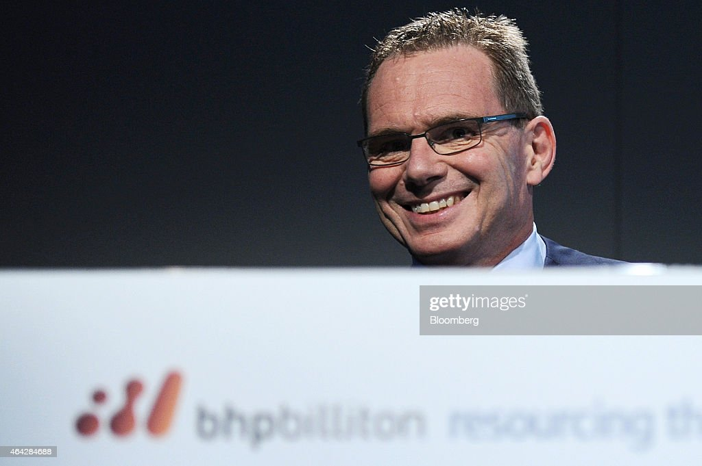 Andrew Mackenzie chief executive officer of BHP Billiton Ltd smiles during an investor briefing at the company's headquarters in Melbourne Australia...