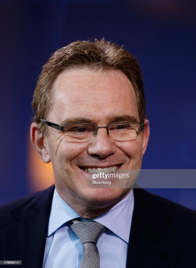 Andrew Mackenzie chief executive officer of BHP Billiton Ltd smiles during an interview during the 2014 IHS CERAWeek conference in Houston Texas US...