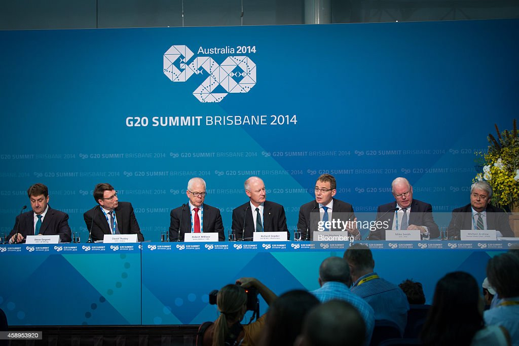 Andrew Mackenzie chief executive officer of BHP Billiton Ltd third right speaks during a news conference with members of the B20 group of executives...