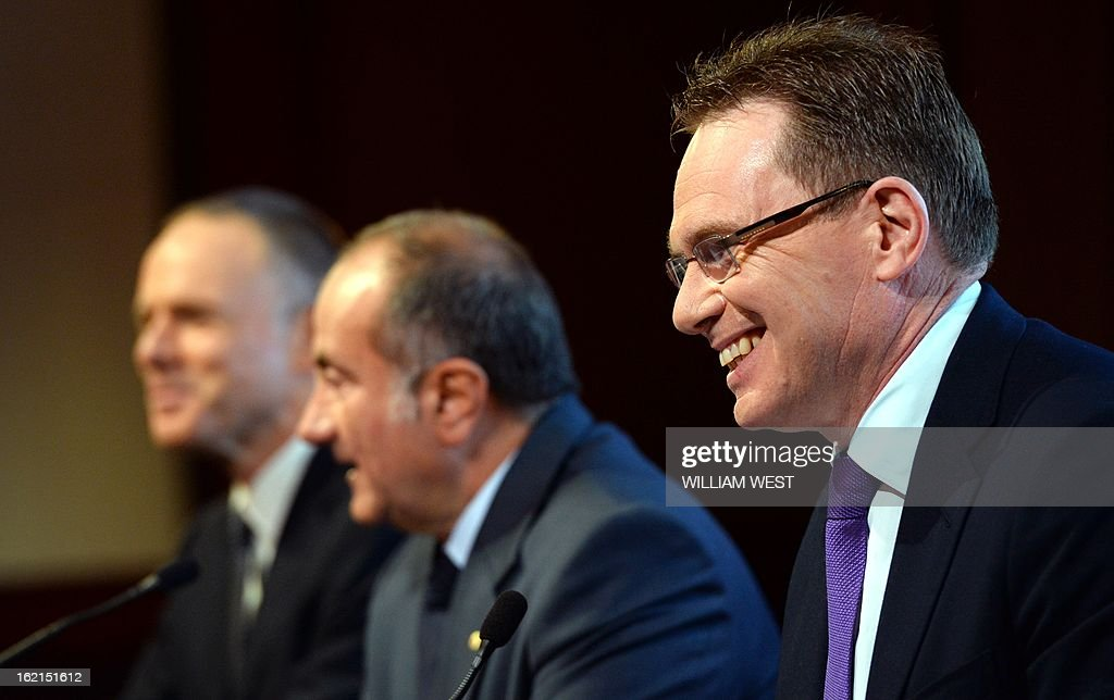 Andrew Mackenzie (R) smiles as it is announced he will be replacing Marius Kloppers (L) as BHP Billiton CEO as company chairman Jac Nasser (C) speaks, in Sydney on February 20, 2013. The 56-year-old Mackenzie, currently chief executive non-ferrous, has over 30 years experience in oil and gas, petrochemicals and minerals and joined BHP Billiton in November 2008. South African Kloppers has been running the world's largest miner since October 2007, steering it through the global financial crisis. AFP PHOTO/William WEST