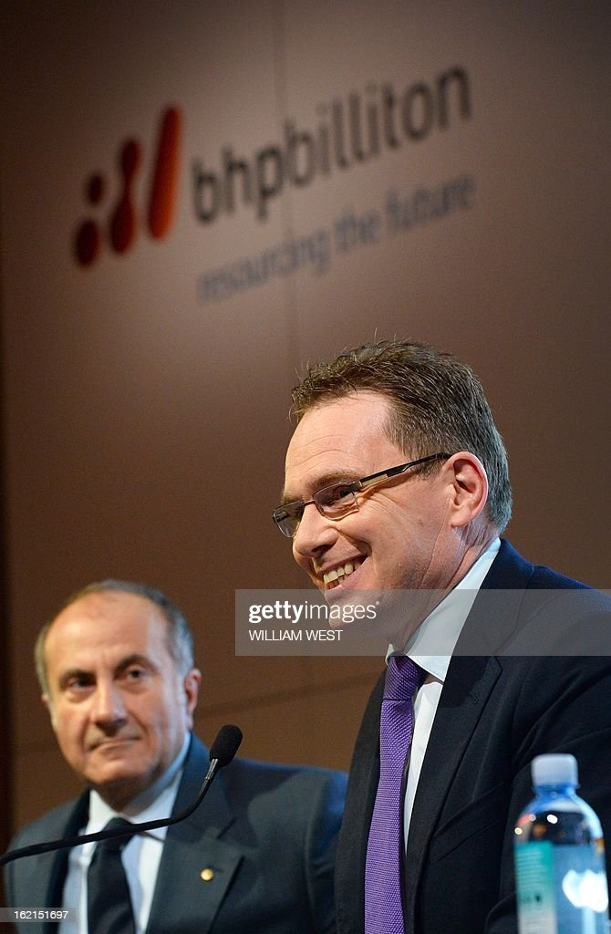 Andrew Mackenzie (R) speaks as it is announced he will be replacing Marius Kloppers as BHP Billiton CEO while company chairman Jac Nasser (L) listens, in Sydney on February 20, 2013. The 56-year-old Mackenzie, currently chief executive non-ferrous, has over 30 years experience in oil and gas, petrochemicals and minerals and joined BHP Billiton in November 2008. South African Kloppers has been running the world's largest miner since October 2007, steering it through the global financial crisis. AFP PHOTO/William WEST