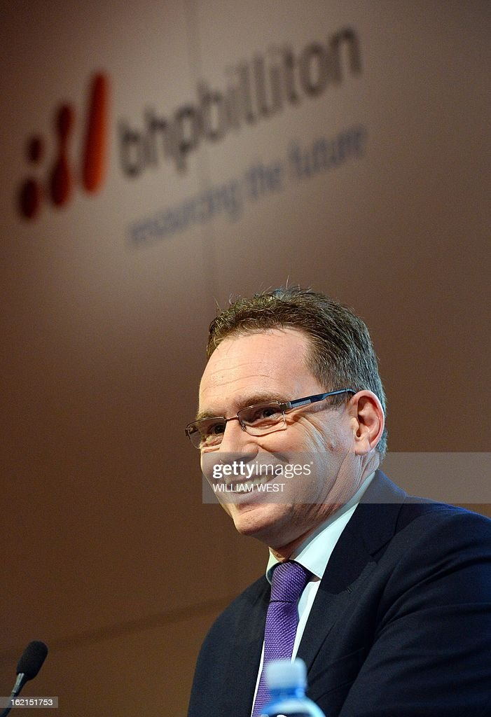 Andrew Mackenzie (R) speaks as it is announced he will be replacing Marius Kloppers as BHP Billiton CEO, in Sydney on February 20, 2013. The 56-year-old Mackenzie, currently chief executive non-ferrous, has over 30 years experience in oil and gas, petrochemicals and minerals and joined BHP Billiton in November 2008. South African Kloppers has been running the world's largest miner since October 2007, steering it through the global financial crisis. AFP PHOTO/William WEST