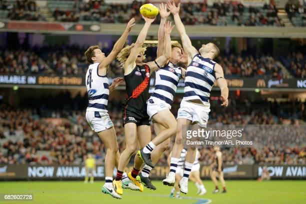 Andrew Mackie Mitch Duncan and Sam Menegola of the Cats compete against Dyson Heppell of the Bombers during the round eight AFL match between the...