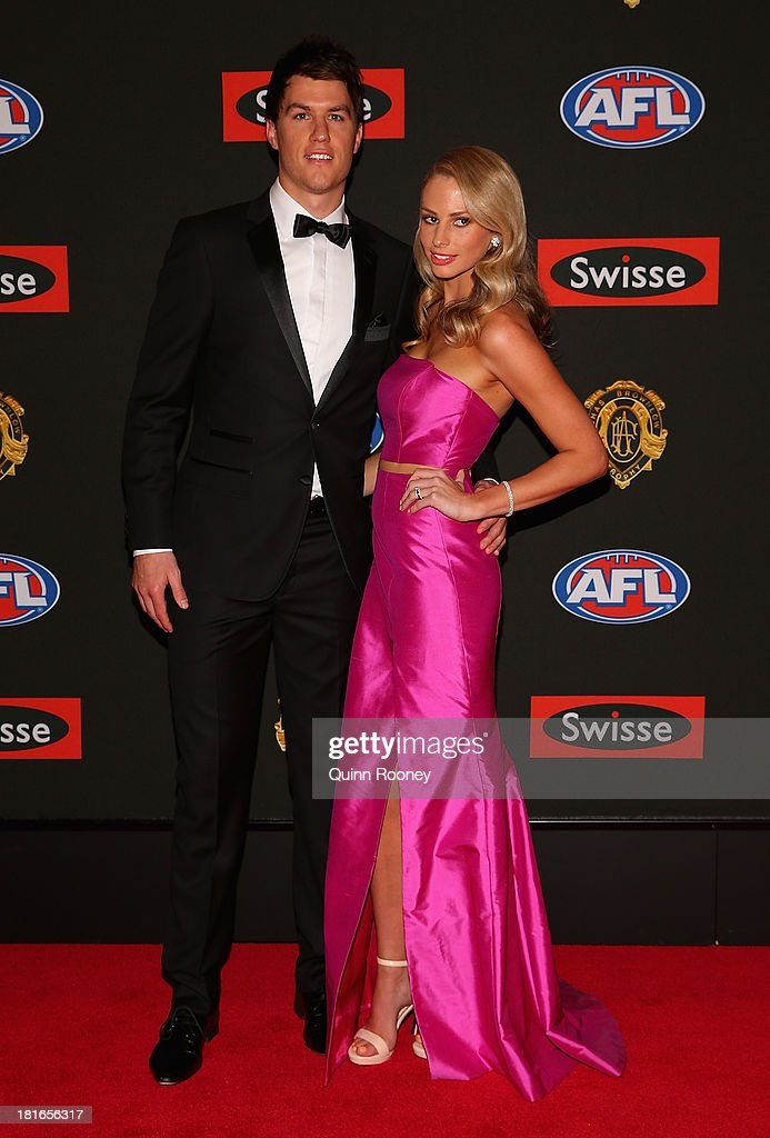 Andrew Mackie of the Cats and his wife Georgia Mackie arrive ahead of the 2013 Brownlow Medal at Crown Palladium on September 23, 2013 in Melbourne, Australia.