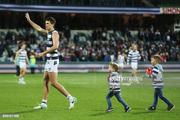 Andrew Mackie of the Cats waves to fans after their win with his kids during the round 23 AFL match between the Geelong Cats and the Greater Western...
