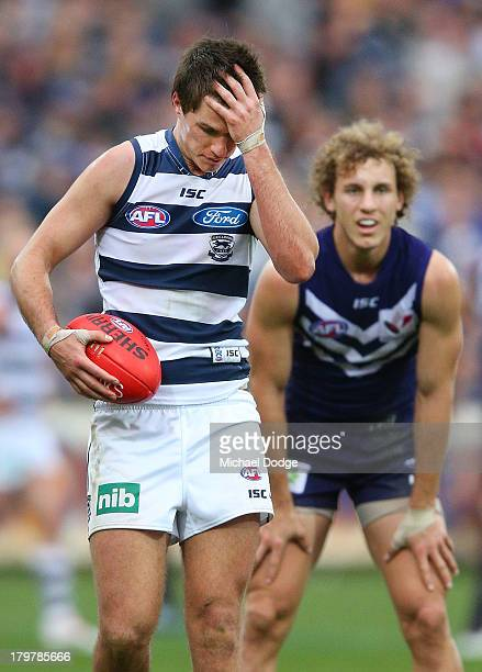 Andrew Mackie rubs his head after a marking contest against Chris Mayne of the Dockers during the Second AFL Qualifying Final match between the...