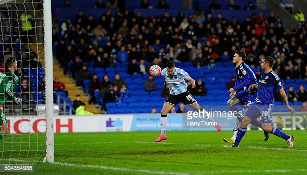 Andrew Mangan of Shrewsbury Town scores his side's first goal during The Emirates FA Cup Third Round match between Cardiff City and Shrewsbury Town...