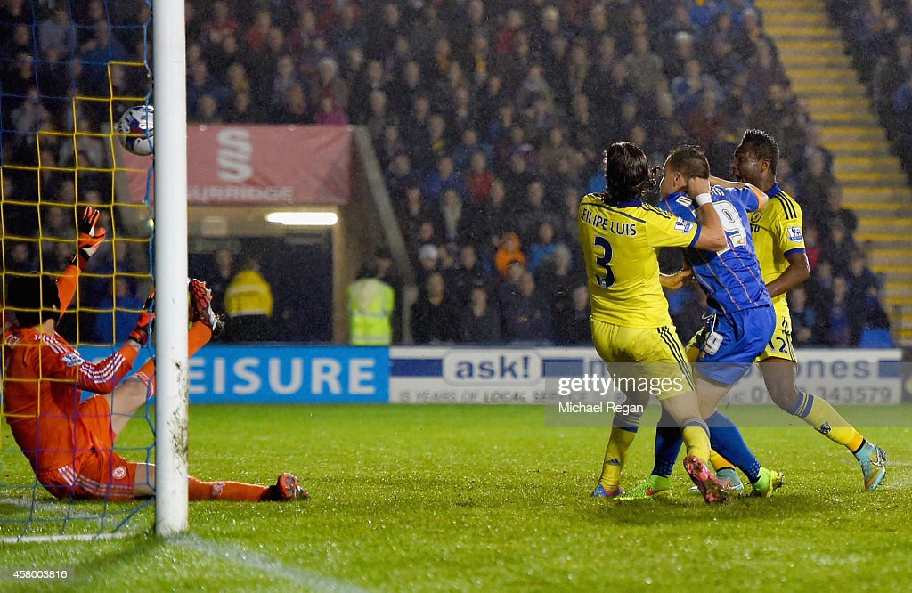 Andrew Mangan of Shrewsbury Town tussles with <a gi-track='captionPersonalityLinkClicked' href=/galleries/search?phrase=Filipe+Luis&family=editorial&specificpeople=3941966 ng-click='$event.stopPropagation()'>Filipe Luis</a> of Chelsea as he scores their first goal past <a gi-track='captionPersonalityLinkClicked' href=/galleries/search?phrase=Petr+Cech&family=editorial&specificpeople=212890 ng-click='$event.stopPropagation()'>Petr Cech</a> of Chelsea during the Capital One Cup Fourth Round match between Shrewsbury Town and Chelsea at Greenhous Meadow on October 28, 2014 in Shrewsbury, England.