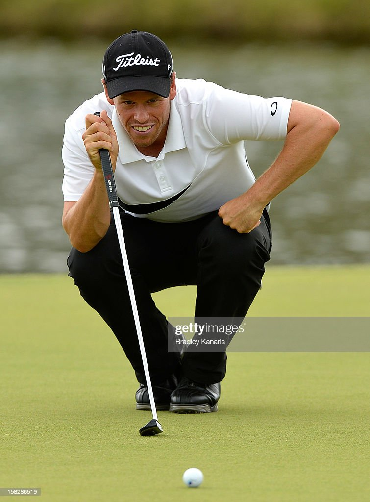 Andrew Martin lines up a putt on the 18th hole during round one of the Australian PGA at the Palmer Coolum Resort on December 13, 2012 in Sunshine Coast, Australia.