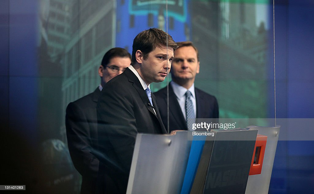 Andrew Mason chief executive officer of Groupon Inc center speaks at the Nasdaq MarketSite in New York US on Friday Nov 4 2011 Groupon Inc relied on...