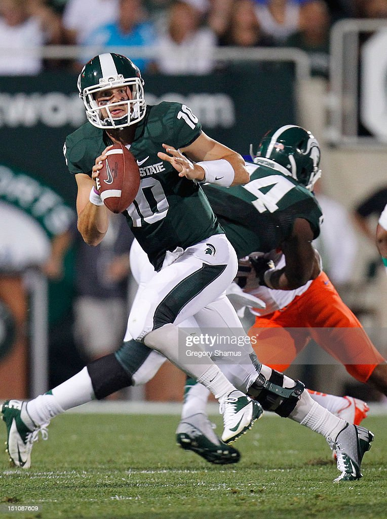 Andrew Maxwell #10 of the Michigan State Spartans looks for an open receiver while playing the Boise State Broncos at Spartan Stadium on August, 2010 in East Lansing, Michigan.
