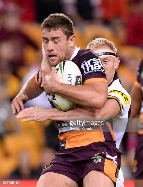Andrew McCullough of the Broncos attempts to break free from the defence during the round nine NRL match between the Brisbane Broncos and the Penrith...