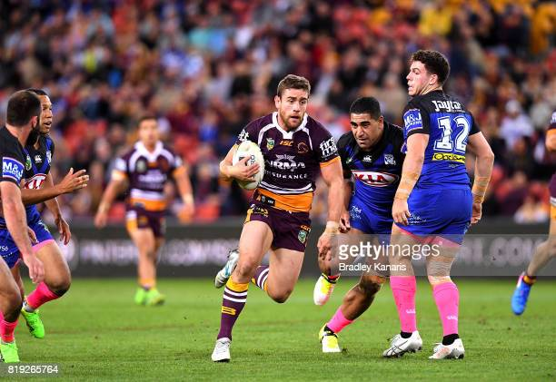 Andrew McCullough of the Broncos breaks through the defence during the round 20 NRL match between the Brisbane Broncos and the Canterbury Bulldogs at...