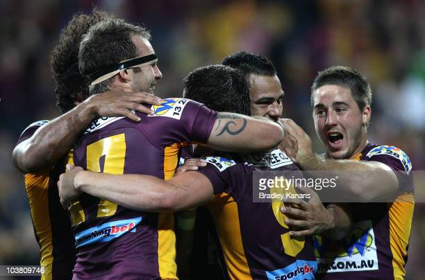 Andrew McCullough of the Broncos celebrates with team mates after scoring a try during the round 26 NRL match between the Brisbane Broncos and the...