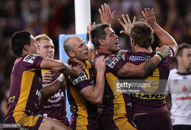 Andrew McCullough of the Broncos celebrates with team mates after scoring a try during the NRL 2nd Qualifying Final match between the Brisbane...