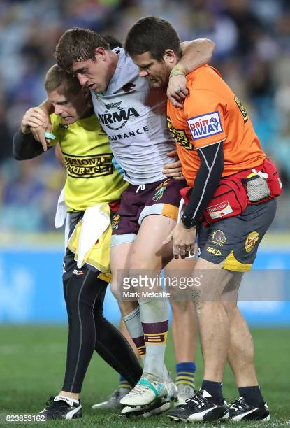 Andrew McCullough of the Broncos is carried from the field injured during the round 21 NRL match between the Parramatta Eels and the Brisbane Broncos...