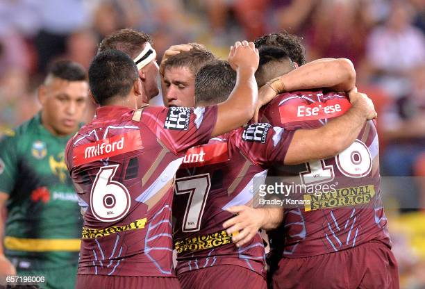 Andrew McCullough of the Broncos is congratulated by team mates after scoring a try during the round four NRL match between the Brisbane Broncos and...