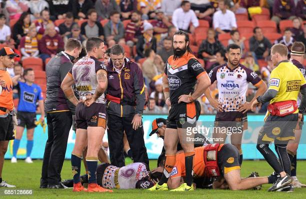 Andrew McCullough of the Broncos is injured during the round 11 NRL match between the Brisbane Broncos and the Wests Tigers at Suncorp Stadium on May...