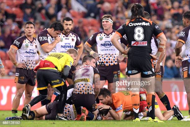 Andrew McCullough of the Broncos is seen to be a trainer after being injured during the round 11 NRL match between the Brisbane Broncos and the Wests...