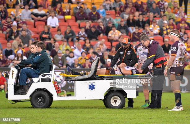 Andrew McCullough of the Broncos is taken from the field injured during the round 11 NRL match between the Brisbane Broncos and the Wests Tigers at...