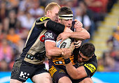 Andrew McCullough of the Broncos is wrapped up by the defence during the round 20 NRL match between the Brisbane Broncos and the Penrith Panthers at...